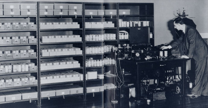 """""""Robert Winslow Gordon, first head of the Archive of American Folk-Song, at the Library of Congress, with part of the cylinder collection and recording machinery, about 1930."""" Library of Congress"""