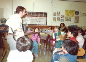 Norman Ross sings with kids, circa 1980s.