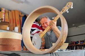 Simon Middleton with a prototype Shackleton banjo, with optional Oak & Birch rim in foreground