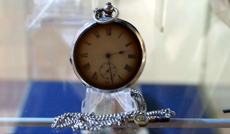 Pocket watch recovered from the Titanic, frozen at the time it entered the water (photo by Caro Wallis, edited, Creative Commons license, flickr)
