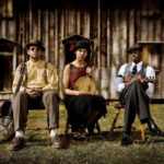 The Carolina Chocolate Drops of Durham, NC pose at an old Plantation in their home town.
